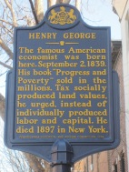 Sign post in front of the Henry George Birthplace, Archive, and Historical Research Center